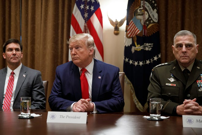 President Donald Trump, joined by from left, Defense Secretary Mark Esper, and Chairman of the Joint Chiefs of Staff Gen. Mark Milley, pauses as he speaks to media during a briefing with senior military leaders in the Cabinet Room at the White House in Washington, Monday, Oct. 7, 2019. (AP Photo/Carolyn Kaster)