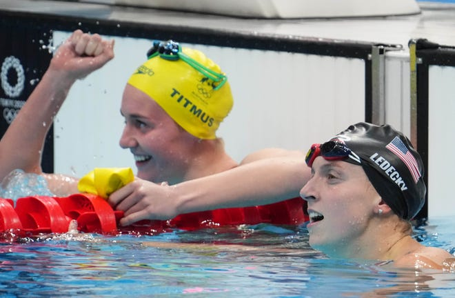 Katie Ledecky (USA) reacts after finishing second to Ariarne Titmus (AUS) in the women's 400m freestyle final during the Tokyo 2020 Olympic Summer Games at Tokyo Aquatics Centre.