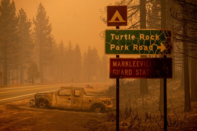 The Tamarack Fire left a scorched car on the roadside in the Markleeville community of Alpine County, Calif., on July 17.