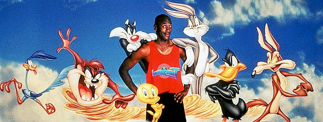 """Michael Jordan surrounded by Warner Bros. Looney Tunes characters to promote """"Space Jam."""""""