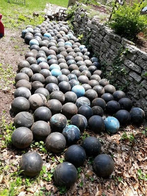 Olson's final count of the buried bowling balls totaled 158, though he said there are definitely more still buried.