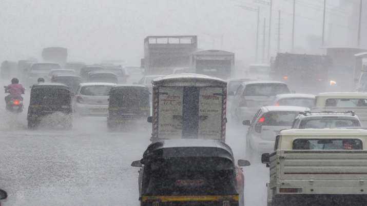 Vehicles during heavy rain shower at Western Express