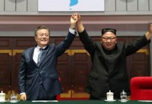 North and South Korea restart hotline and pledge to improve ties