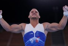 Samir Ait Said of France celebrates after performing on the rings Saturday.