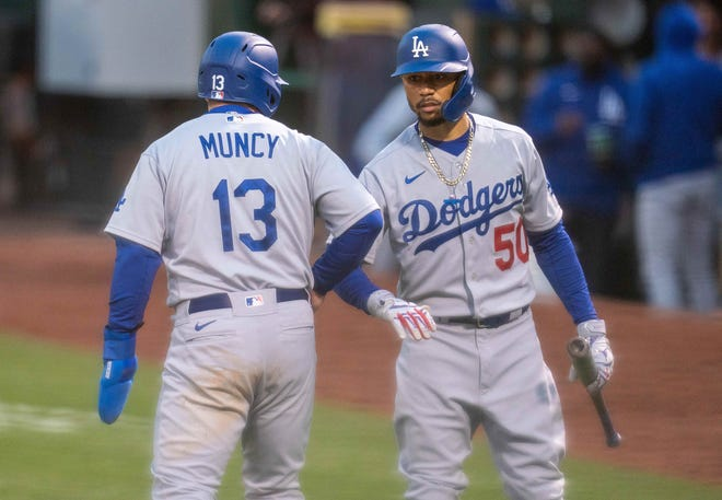 The Dodgers' Max Muncy, an All-Star for the second time this season, leads the majors in on-base percentage, while teammate Mookie Betts made the team for the fifth time.