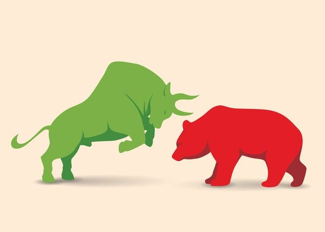 A bull and a bear facing each other