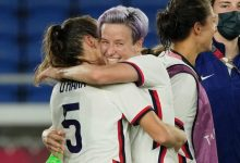 USWNT forward Megan Rapinoe (15) hugs defender Kelley O'Hara (5) after their win over the Netherlands in the quarterfinals of the Tokyo Olympics.