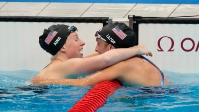 U.S. swimmers Lilly King and Annie Lazor celebrate their medal-winning performances in the women's 200-meter breaststroke at Tokyo Aquatics Centre.