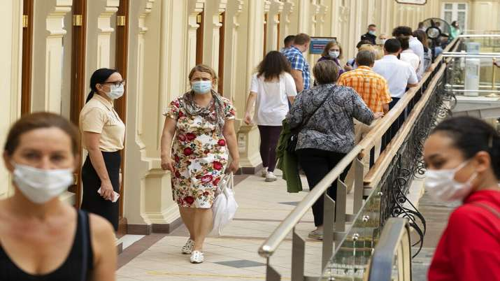 People wait in line to get a coronavirus vaccine at a
