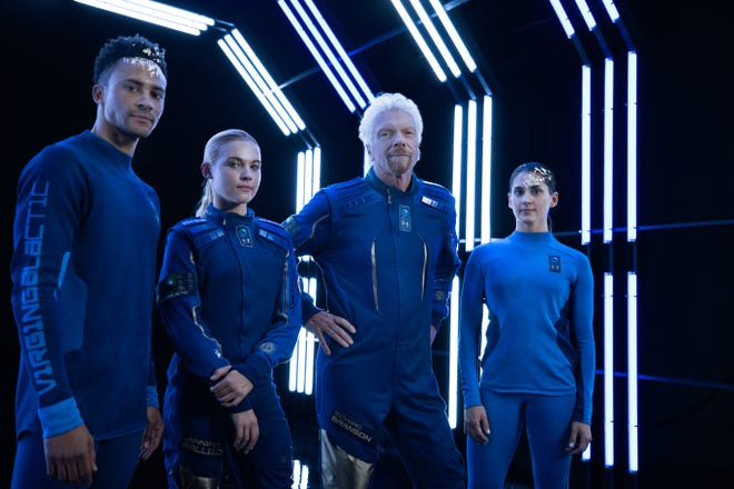 Virgin Galactic and manufacturer Under Armour unveiled the first line of spacewear designed for Virgin Galactic crew members, including commercial passengers, in New York City on Oct. 15, 2019. In the center is Virgin Galactic founder Richard Branson.