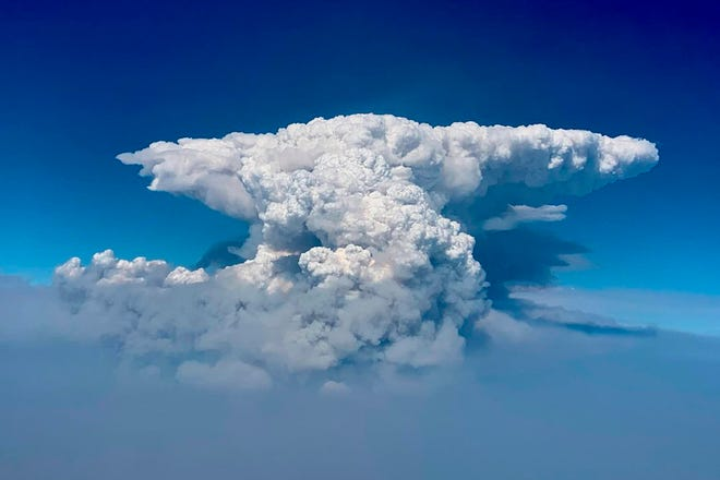 In this photo taken with a drone provided by the Bootleg Fire Incident Command, a pyrocumulus cloud, also known as a fire cloud, is seen over the Bootleg Fire in southern Oregon on Wednesday, July 14, 2021.