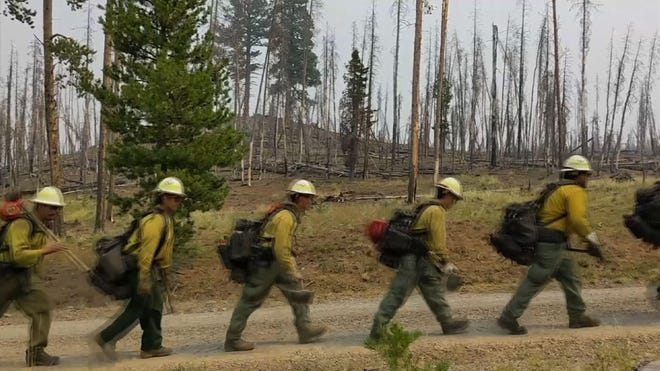 Wildfires scorch Western US as homes burn and thousands threatened