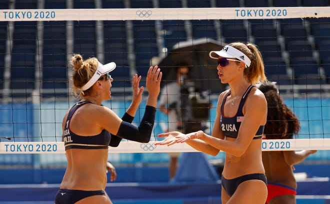 The U.S. beach volleyball A team of April Ross, left, and Alix Klineman defeated Cuba on Monday in their first match of the knockout round.