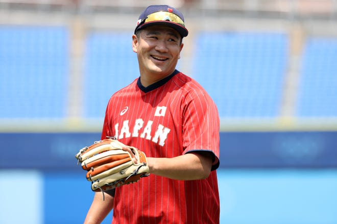 Masahiro Tanaka warms up before Japan's game against Mexico during the opening round of the Olympic baseball tournament.