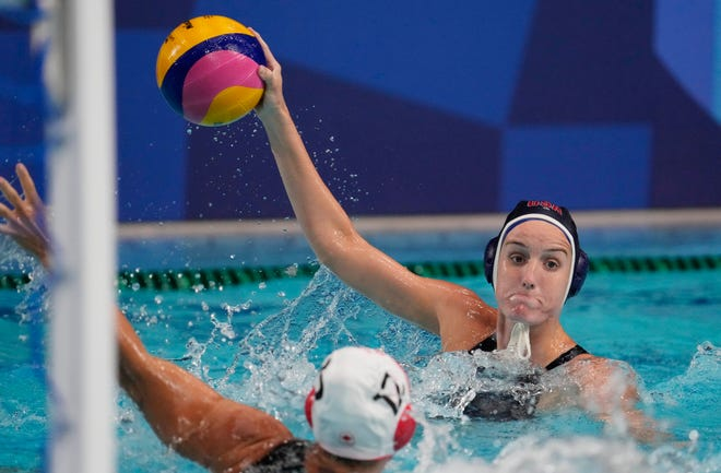The USA's Alys Williams controls the ball during the quarterfinal game against Canada.