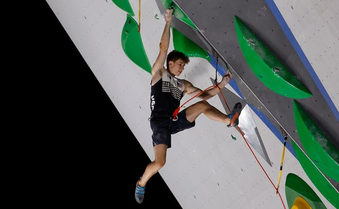 Colin Duffy of the United States competes in lead qualification of sport climbing.