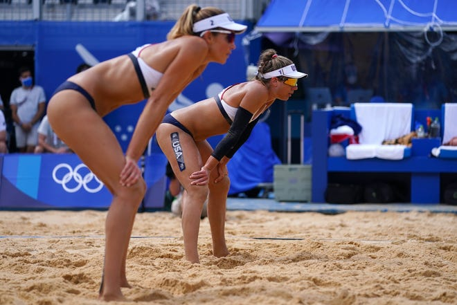 Alix Klineman, left, and April Ross, right, get set for a serve during a Tokyo 2020 Olympic Summer Games match against Germany at Shiokaze Park in Tokyo, Japan.
