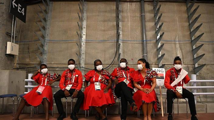 Angolan athletes wait backstage ahead of the opening ceremony for the Tokyo Paralympic games