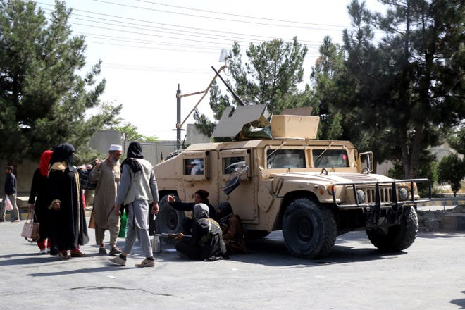 Taliban fighters guard outside the airport in Kabul, Afghanistan, on Aug. 27, 2021, a day after deadly attacks.