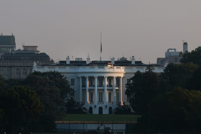 The flag atop the White House stands at half staff to honor the U.S. service members killed in terror attacks in Kabul, Afghanistan, on Aug. 27.