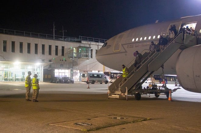 In a photo from Aug. 16, 2021, provided by the British Ministry of Defence, the first flight carrying evacuated personnel of British Embassy staff and various British Nationals, arriving from Kabul at RAF Brize Norton in England.
