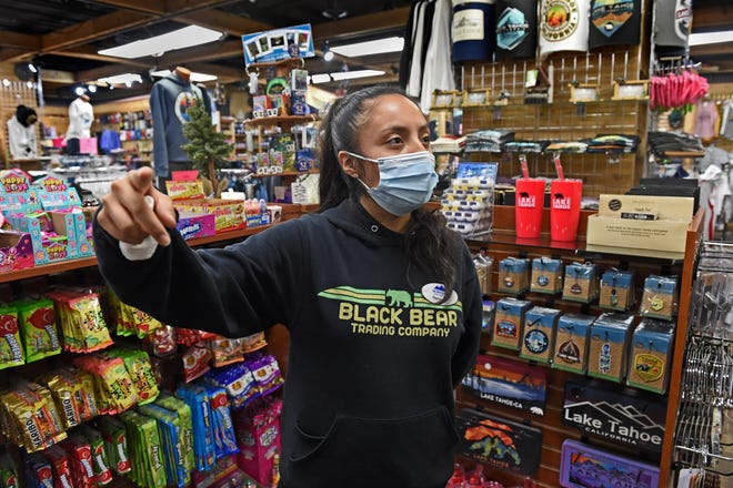 Nahani Sandoval, Black Bear Trading Co. Asst. Manager in South Lake Tahoe, talks about the effects of the Caldor Fire burning near the popular Stateline area on August 27, 2021.