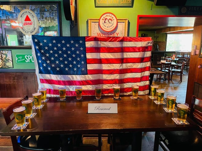 AJOBrady's owner Bruce Russell said the staff hoped to honor the soldier's sacrifices by placing 13 beers out for them.