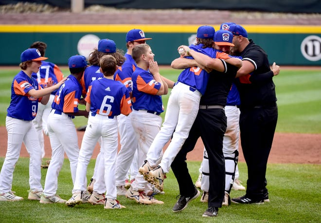 Michigan players and coaches celebrate after beating Ohio 5-2 to win the 2021 Little League World Series championship.