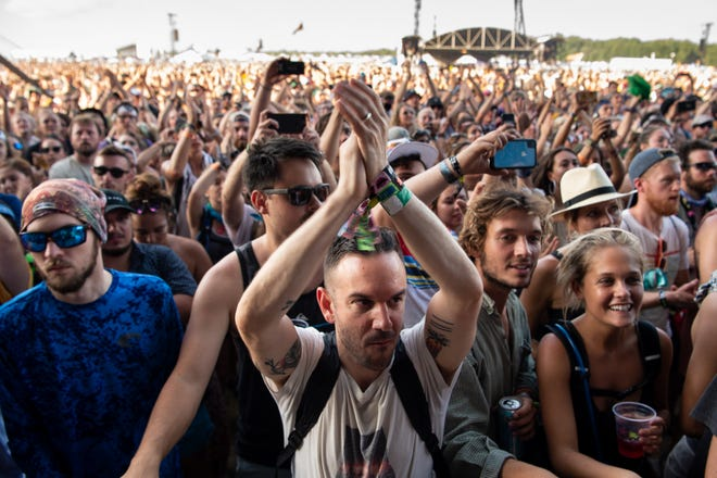 Fans clap as The Lumineers perform at the Bonnaroo Music and Arts Festival in Manchester, Tenn., Sunday, June 16, 2019.