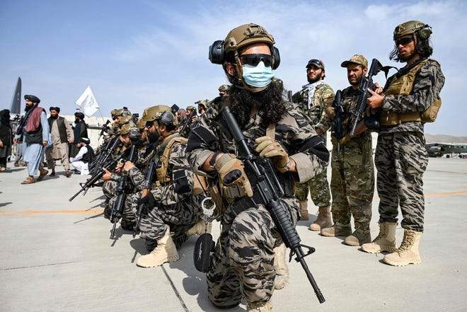 Taliban Badri special force fighters take a position at the airport in Kabul on Aug. 31, 2021, after the US has pulled all its troops out of the country to end a brutal 20-year war -- one that started and ended with the hardline Islamist in power.