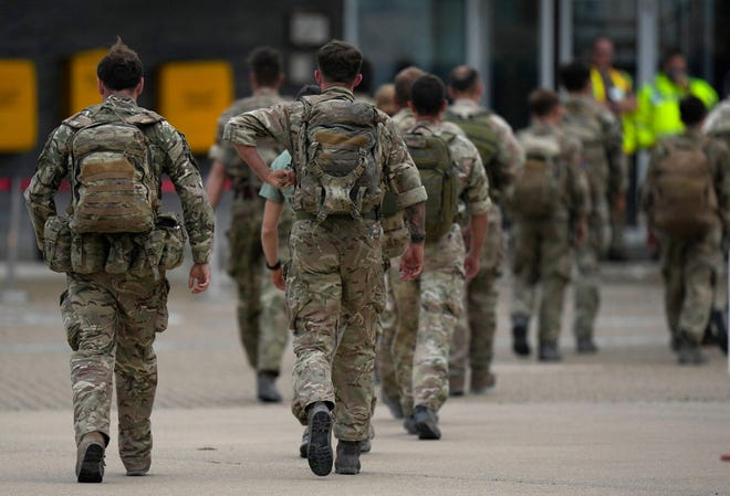 Members of the British armed forces 16 Air Assault Brigade walk to the air terminal after disembarking a Royal Airforce Voyager aircraft at Brize Norton, Oxfordshire on August 28, 2021, as the troops return from assisting with the evacuation of people from Kabul airport in Afghanistan. - The UK is winding up its operation to airlift civilians ahead of the August 31 deadline for US troop withdrawal as Taliban forces prepare to take over the airport. (Photo by Alastair Grant / POOL / AFP) (Photo by ALASTAIR GRANT/POOL/AFP via Getty Images) ORG XMIT: 0 ORIG FILE ID: AFP_9LT3DZ.jpg