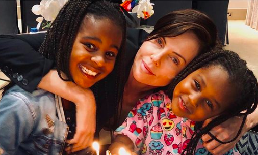Charlize Theron and her 2 daughters are having the best summer ever: 'Me and my girls 4 life'