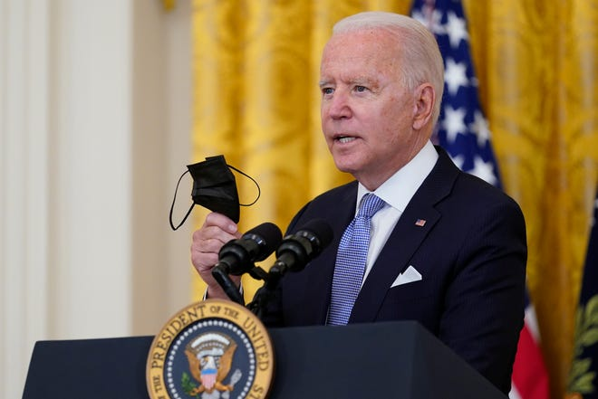 President Joe Biden urges people to get vaccinated and wear masks.