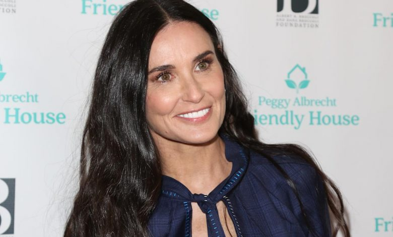 Demi Moore stuns in a red one piece bathing suit
