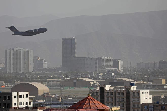 A US Air Force aircraft takes off from the military airport in Kabul on Aug. 27, 2021, as the Pentagon said the evacuation of tens of thousands of people from Afghanistan still faces more possible attacks like the bombing that killed scores of people outside the Kabul airport.