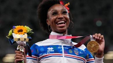 Jasmine Camacho-Quinn, of Puerto Rico, poses with her gold medal after winning the women's 100-meters hurdles final at the 2020 Summer Olympics, Monday, Aug. 2, 2021, in Tokyo. (AP Photo/Francisco Seco)