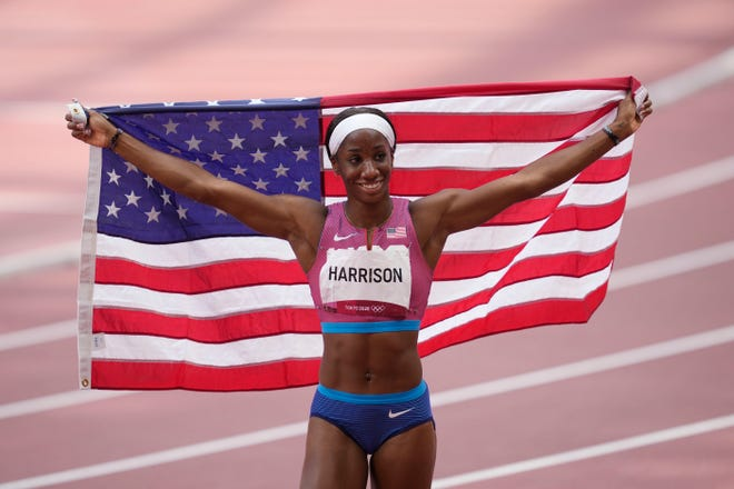 Keni Harrison celebrates after winning the silver medal in the women's 100-meter hurdles at the Tokyo Olympics.