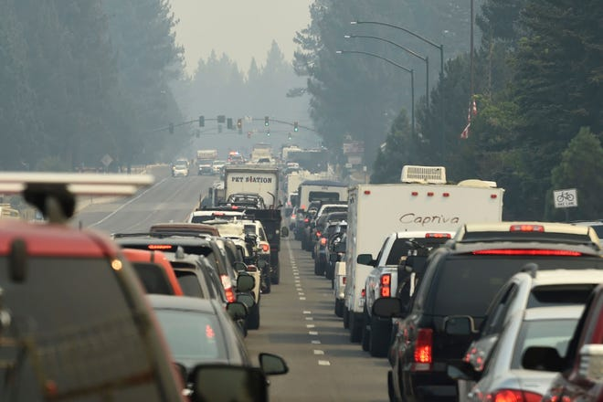 Evacuation traffic backs up in South Lake Tahoe, Calif., as mandatory evacuations are announced due to the Caldor Fire on  Aug. 30, 2021. Thousands of people rushed to get out of South Lake Tahoe as the entire tourist resort city came under evacuation orders and wildfire raced toward the large freshwater lake of Lake Tahoe, which straddles California and Nevada.