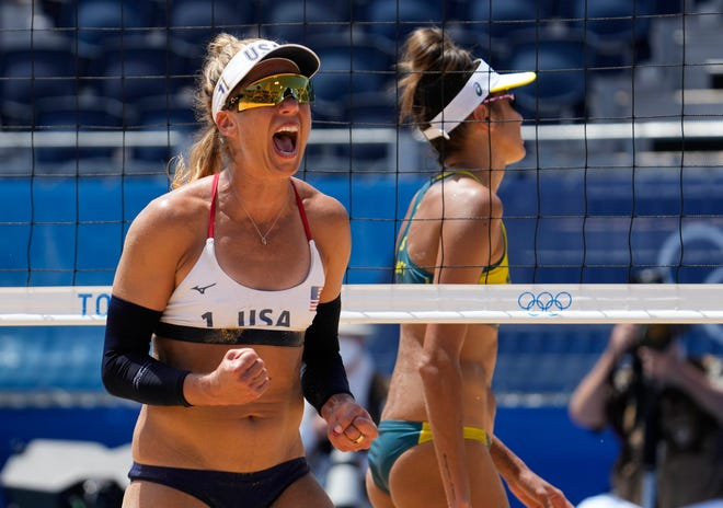 The USA's April Ross celebrates a point against Australia in the women's gold medal beach volleyball match at Shiokaze Park.