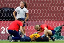 USWNT goalkeeper Alyssa Naeher is checked on by trainers after an injury against Canada.