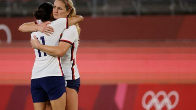 Christen Press, left, and Lindsay Horan console each other after the U.S. lost to Canada in the semifinals at the Tokyo Olympics.