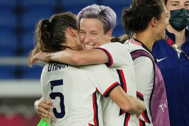 USWNT forward Megan Rapinoe, center, hugs defender Kelley O'Hara after their win over the Netherlands in the quarterfinals of the Tokyo Olympics.