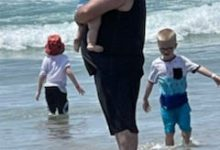 Freedy and three of his five kids spend time at the beach during a trip to San Diego, California.