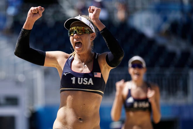 April Ross, left, and teammate Alix Klineman celebrate their semifinal win over Switzerland in the women's beach volleyball semifinals.