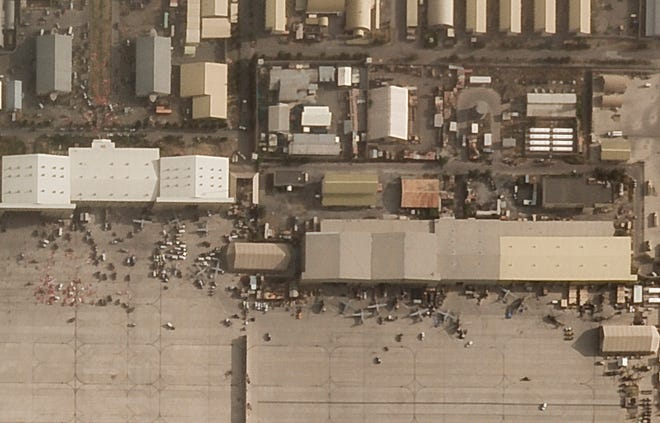 In this satellite photo taken by Planet Labs Inc., abandoned and disabled vehicles and aircraft are seen at Kabul's international airport after the U.S. withdrawal from Afghanistan on Aug. 31, 2021.