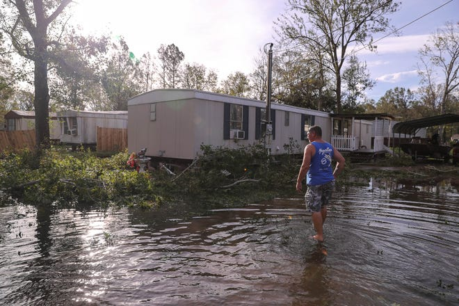 Randy Lirette gets a first look at his home in Schriever, Louisiana on Aug. 30, 2021 following Hurricane Ida. Lirette and his wife Eileen stayed at a hotel in Thibodaux, Louisiana where they waited out the storm.
