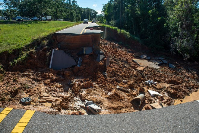 A portion of Highway 26 in the Benndale community in George County washed out Monday night after Hurricane Ida brought torrential rains through the area on Tuesday, Aug. 31, 2021.