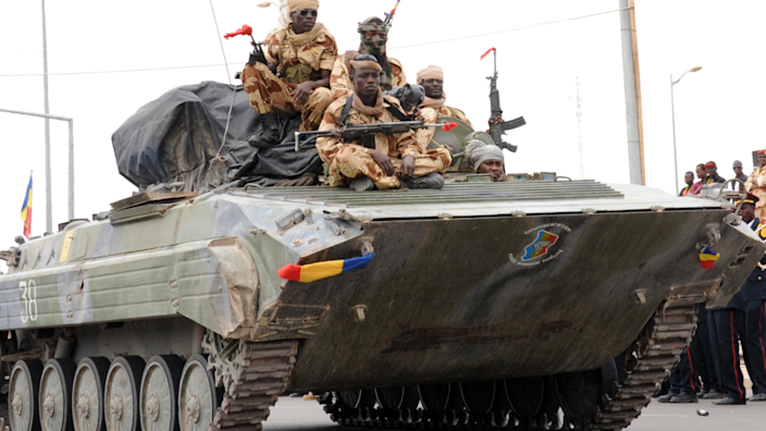 Chadian soldiers returning from Mali sit on a tank during a procession through the capital N'Djamena - 2013