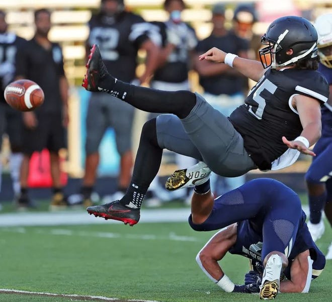 A Bishop Sycamore punter is upended against Archbishop Hoban on Aug. 19.  Since 2020, Bishop Sycamore is winless and has been outscored 342-49.