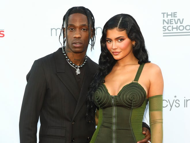 Recording artist Travis Scott, left, and Kylie Jenner, right, attend the 72nd annual Parsons Benefit presented by The New School at The Rooftop at Pier 17 on Tuesday, June 15, 2021, in New York. (Photo by Andy Kropa/Invision/AP) ORG XMIT: NYAK103